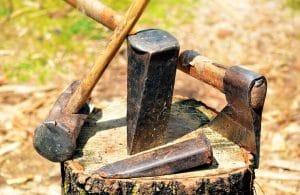 splitting logs with an axe